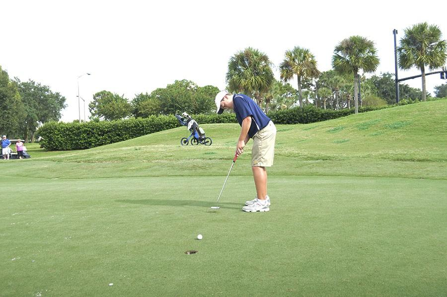 Joseph+Pagdin+hits+a+putt+for+TPS+at+Alaqua+Country+Club+against+Orangewood.