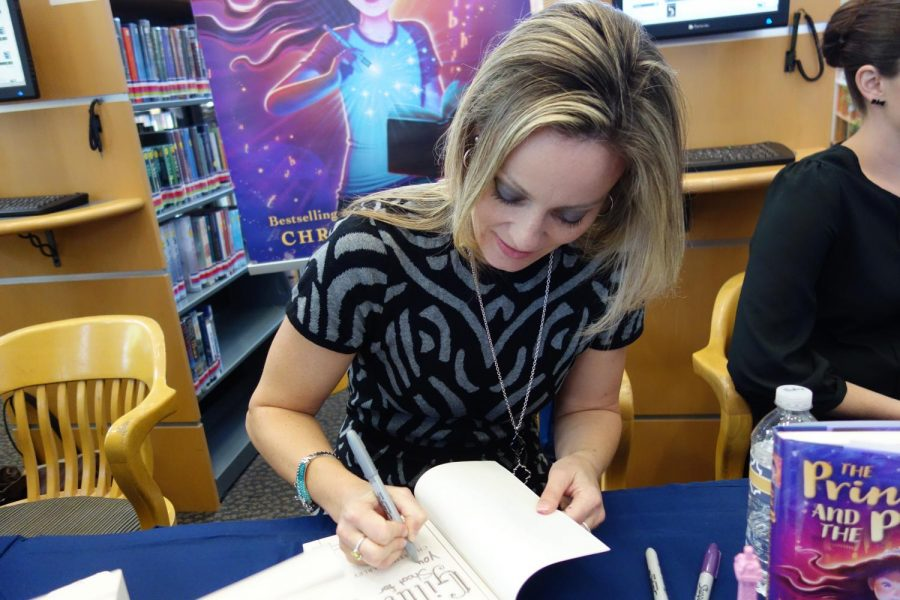 Author Christina Farley signs her book