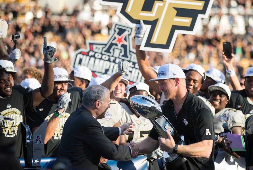 Scott Frost celebrates with his time after their thrilling 62-55 win in the Conference America championship game.