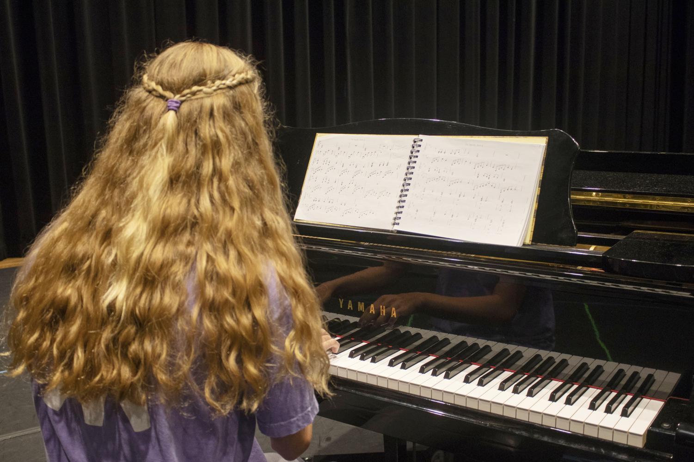 Senior Hallie Hunt '19 performs her originally composed piano piece.