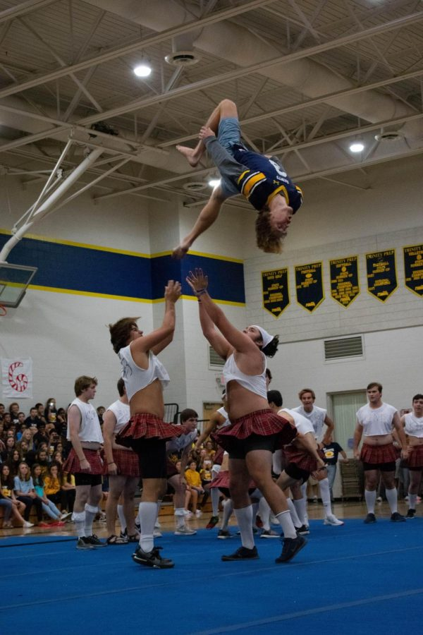 Senior+Ike+Evans+%2719+does+a+backflip+with+the+help+of+Will+Magargee+%2719+and+Brett+Lamoriello+%2719+as+a+part+of+the+Senior+Powderpuff+dance.+Upon+sticking+the+landing%2C+Evans+was+showered+with+cheers+from+the+Senior+class.