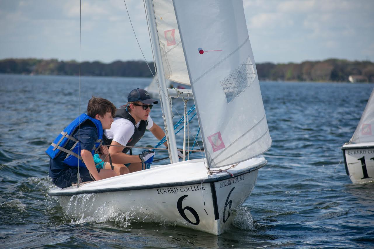 Freshman Nolan Evans and junior Andrew Dryden talk through their plan while waiting for the next practice race to start. Dryden's experience in sailing helps inexperienced sailors like Evans to get an easier grasp on how to efficiently sail and win regattas.
