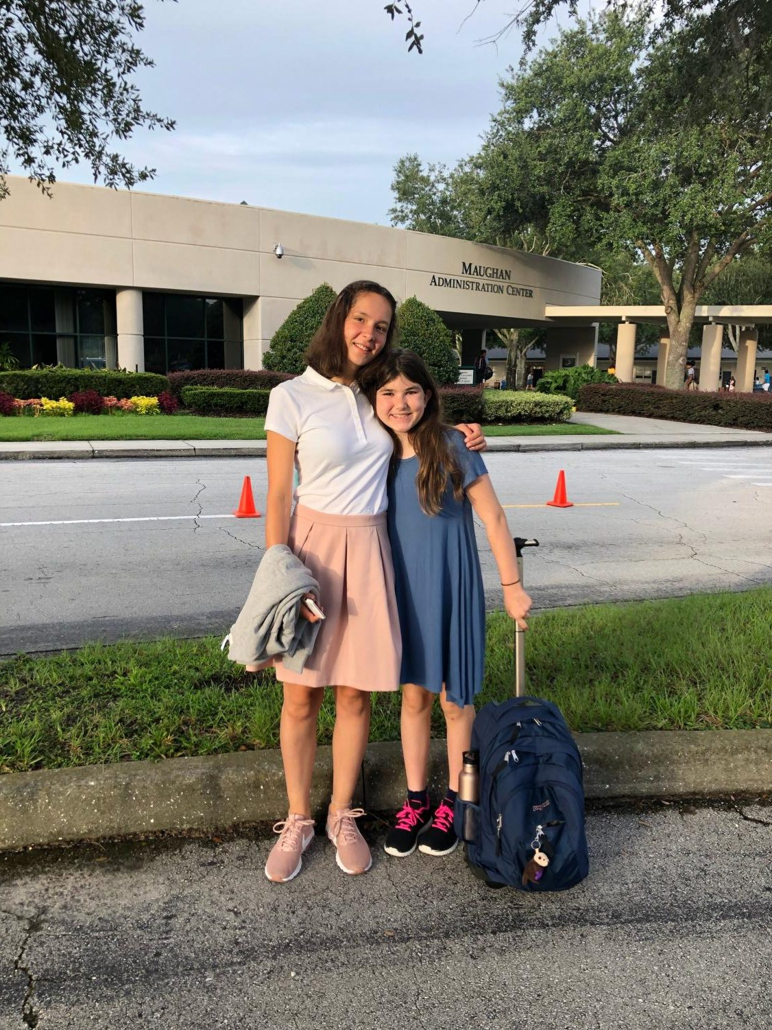 Sophomore Lea Kuehnel smiles for her first day of school with host sister, seventh grader Tori Martin.