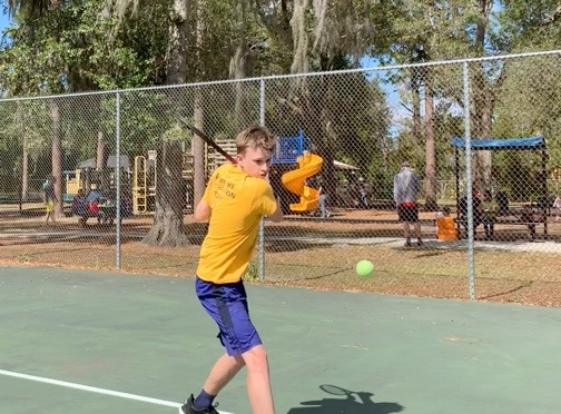 Lachlan Bill continues to practice tennis at Phelps Park