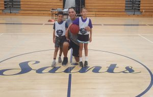 DiGiovanni posing with two of his children, Emma and Miles, during elementary school week at basketball camp.