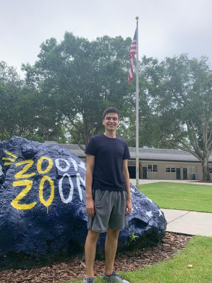 Bozhkov smiles next to the Trinity Rock during his first time on campus. He arrived two weeks before the first day and was excited to finally be on campus.