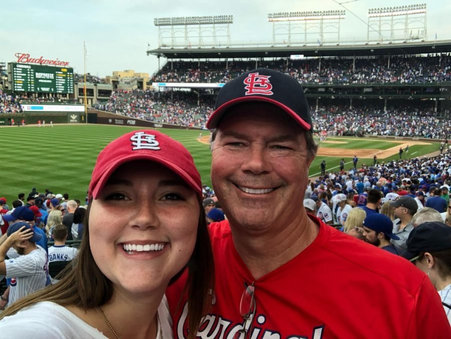 Ms. Loudon and her father at a baseball game.