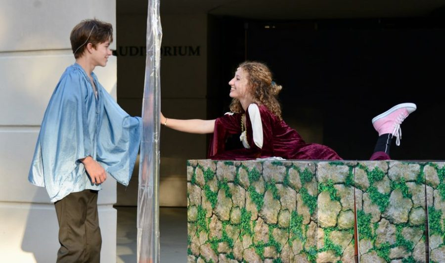 Romeo, Dalton Joseph, and Juliet, Layla Kaplan, talk through a clear screen