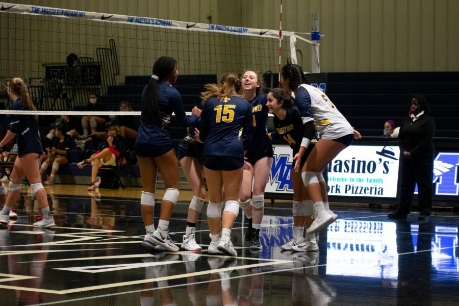 The Varsity Volleyball players celebrate their win in the district quarterfinals against Windermere Prep. After winning 3-0, the team advanced to the district semifinals to compete against The First Academy.