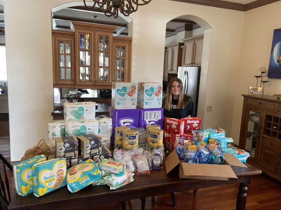 Driscoll+poses+in+front+of+the+collected+supplies.+Most+donors+chose+to+give+directly+through+her+Amazon+wishlist+with+the+supplies+being+shipped+directly+to+her+house.