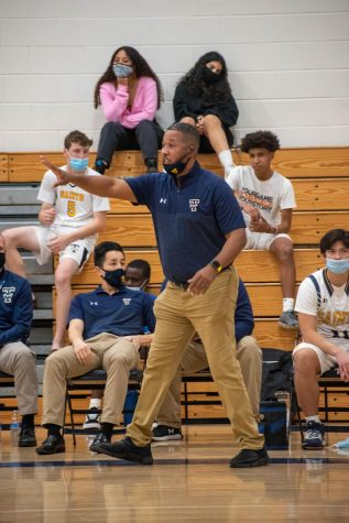 The new basketball coach, Irwin Hudson, calls out a play. The team played their first preseason game against Windermere Prep.