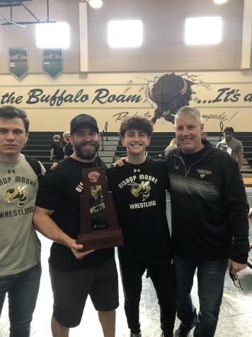 Eliason (far right) at a wrestling meet at his previous school.