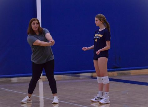 Head JV volleyball coach, Hannah Young, teaches her players the correct way to pass the ball. This is her first year coaching JV.