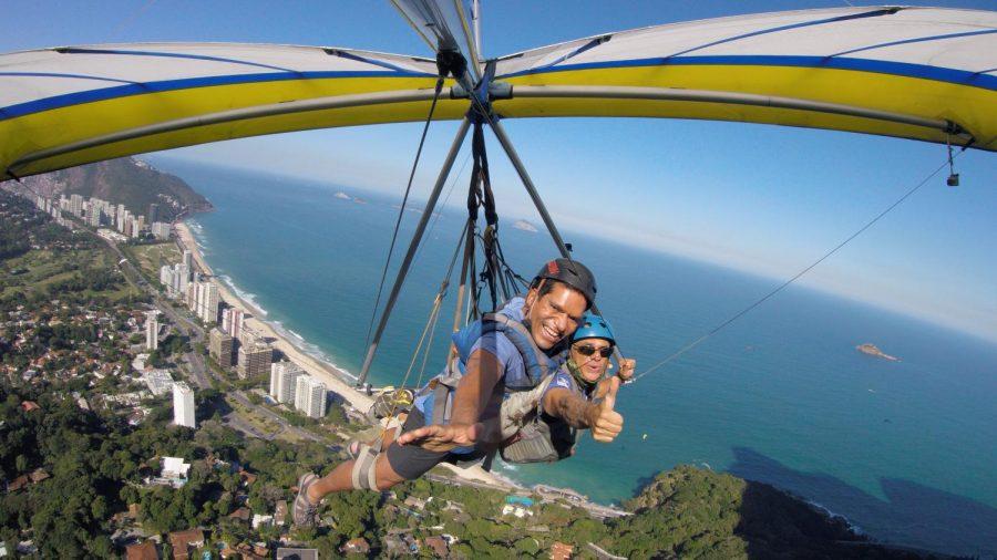 Figueroa-Ortiz+%28pictured+left%29+goes+hang+gliding+with+a+guide+in+Rio+de+Janiero%2C+Brazil.